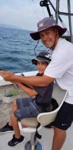 family having fun fishng in puerto vallarta