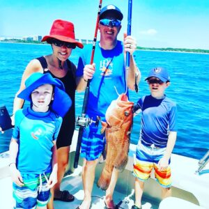 """Family with a """"baqueta"""" or red snapper"""